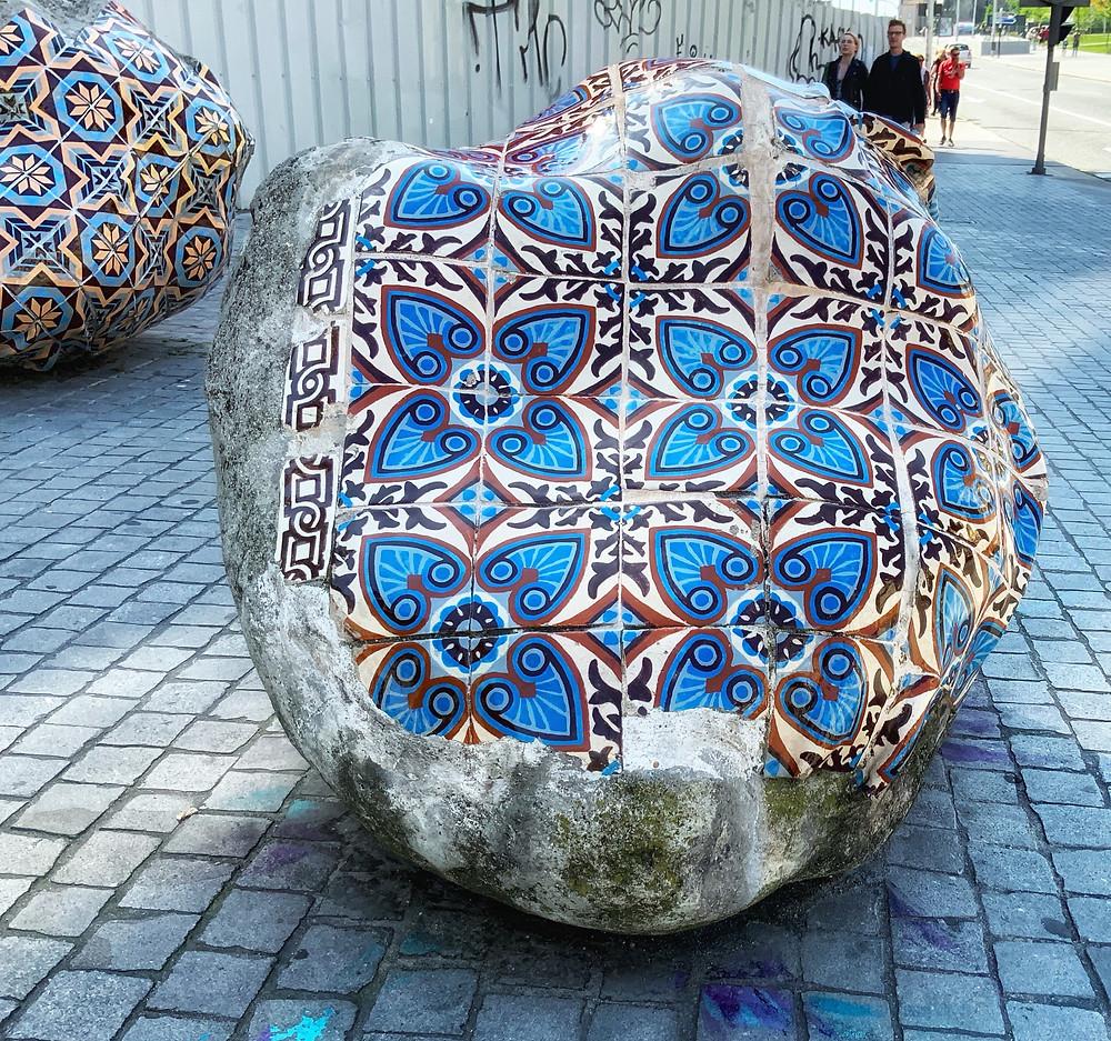 azulejos on boulders outside Sao Bento train station in Porto
