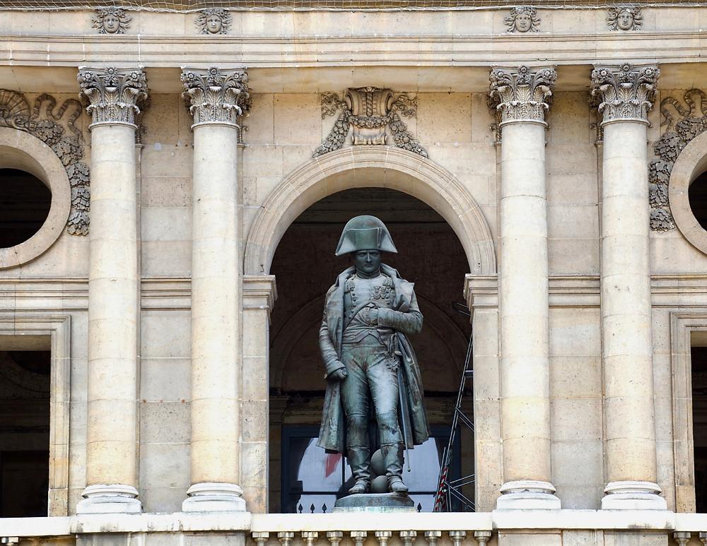 a statue of Napoleon guards Les Invalides