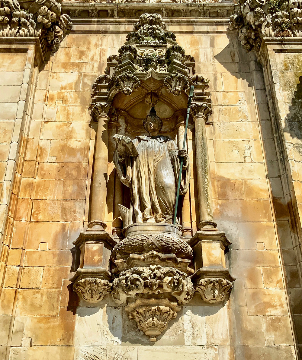 statue of St. Benedict on the facade of Alcobaça Monastery