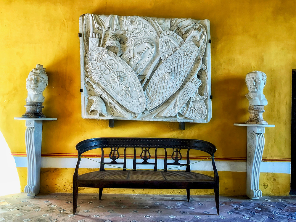the ochre hued Golden Room containing classical sculptures and reliefs from Italy