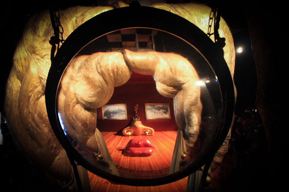 view of the Mae West Room, seen through a sculpture of blond hair, as Dali intended