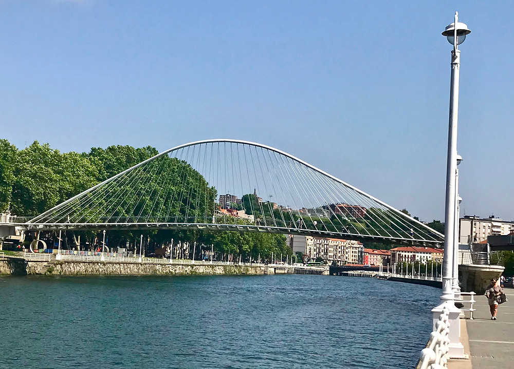 the 1997 glass bottomed Zubizuri Bridge in Bilbao