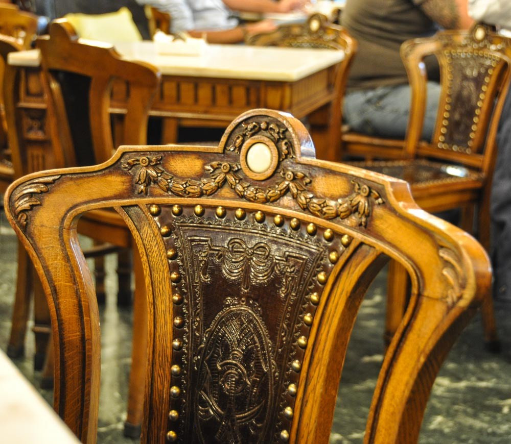 the intricate chairs at Cafe Majestic