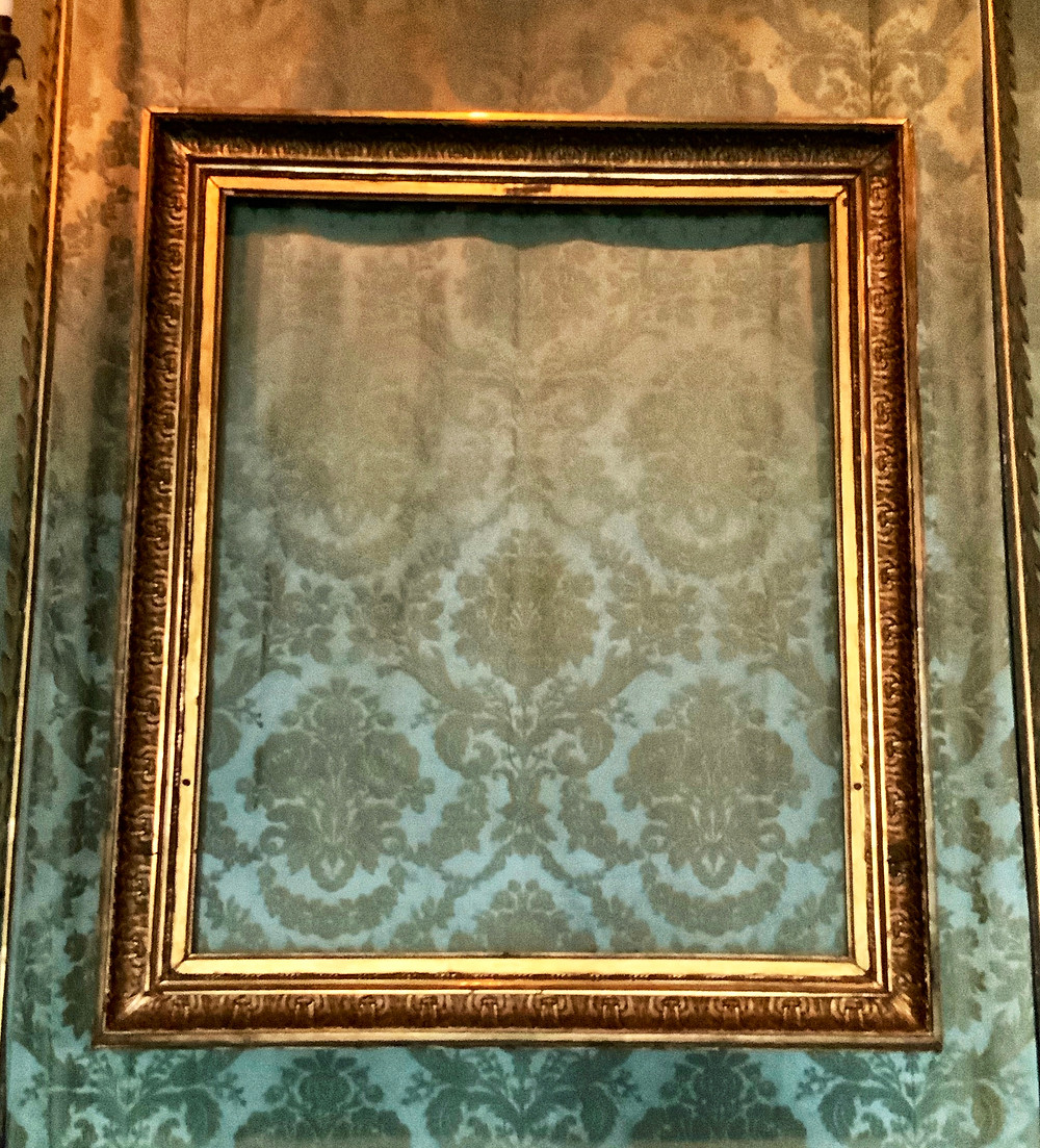 an empty frame where a Rembrandt used to be in the Dutch Room