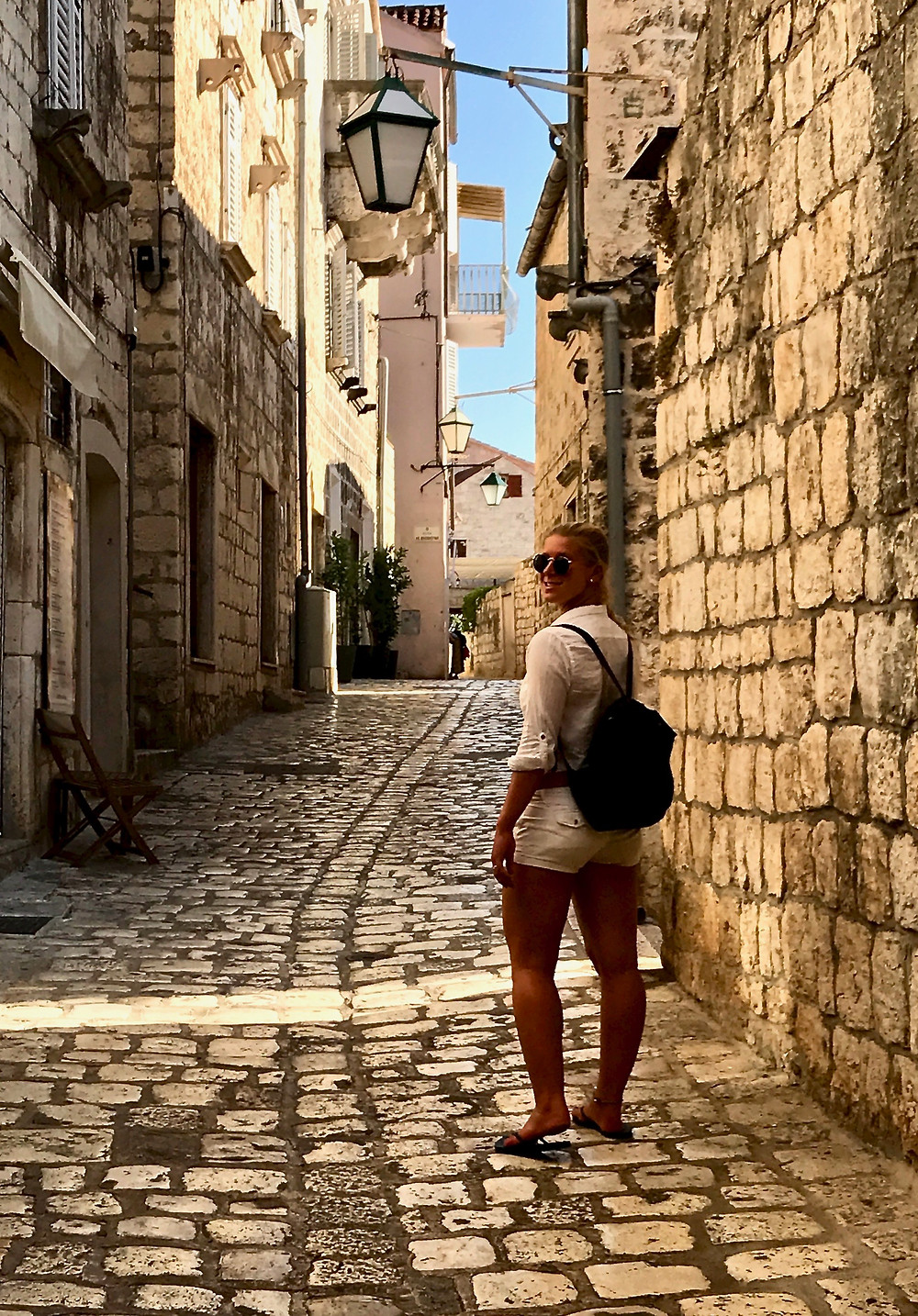 my daughter on the limestone streets of Hvar