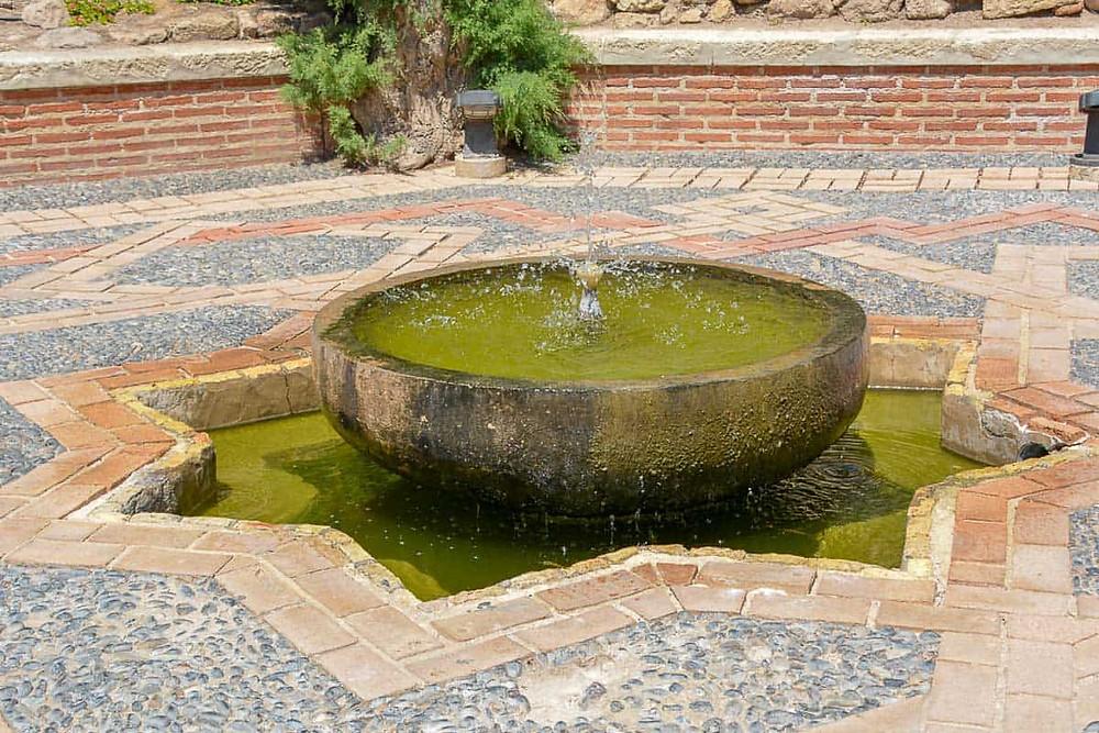 a fountain in the Alcazaba gardens