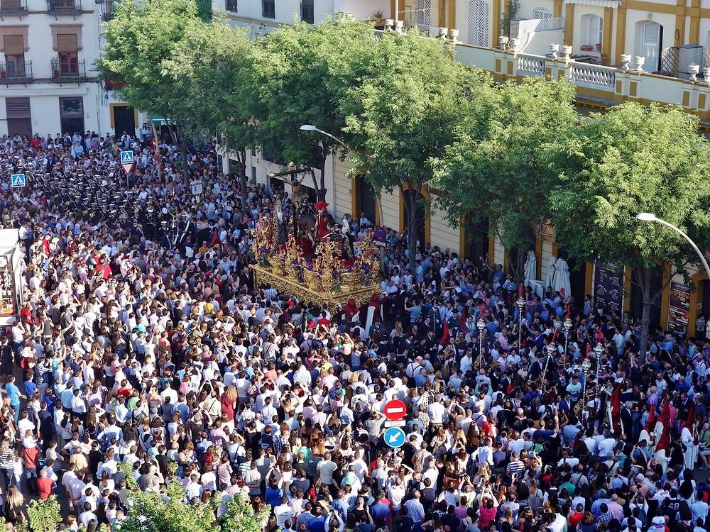 Crowds in Seville during Holy Week. Image source: Devour Seville
