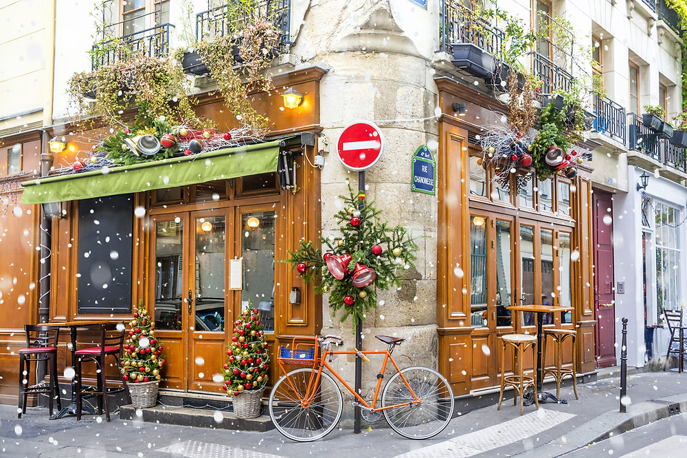 pretty Paris cafe, decorated for Christmas on a wintery day