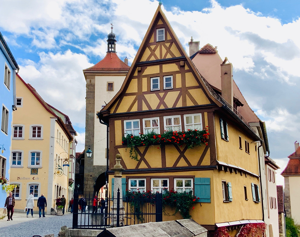 the yellow half timbered house in the quaint area of Plonlein in Rothenburg ob der Tauber