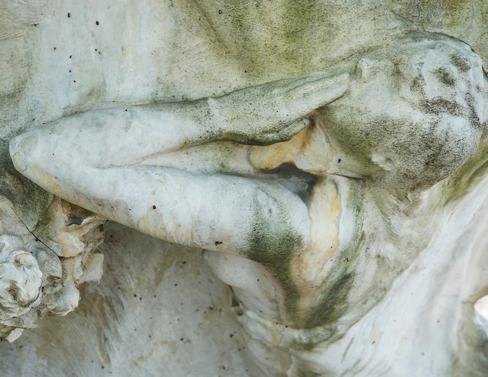 sculpture of a grieving figure