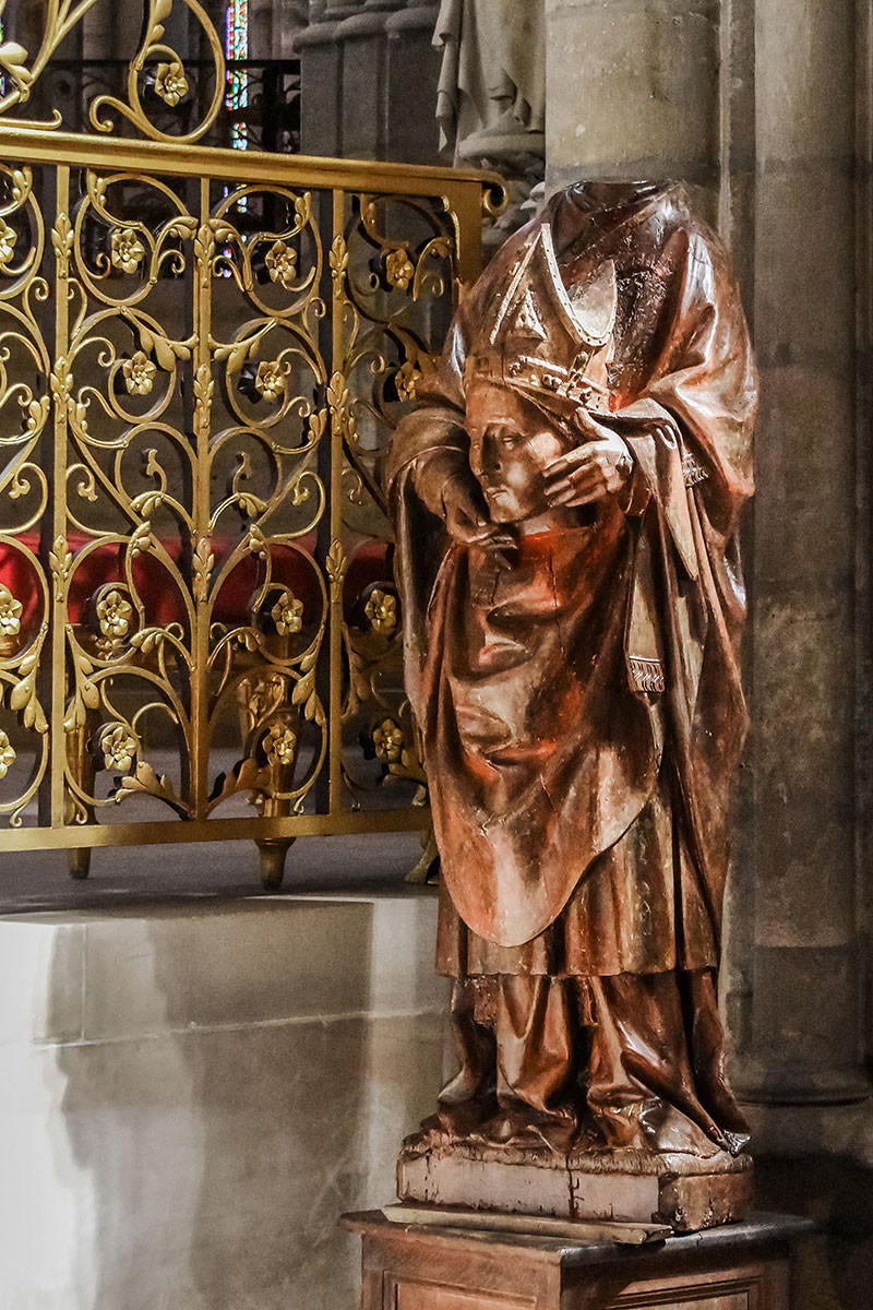 a wooden statue of the famous Cephalophore, Saint Denis, in the choir