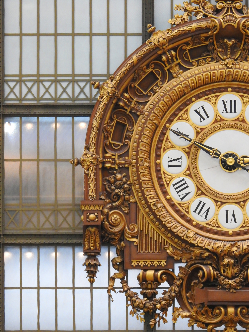 the iconic grand clock of the Musee d'Orsay, a leftover from its previous incarnation as a train station
