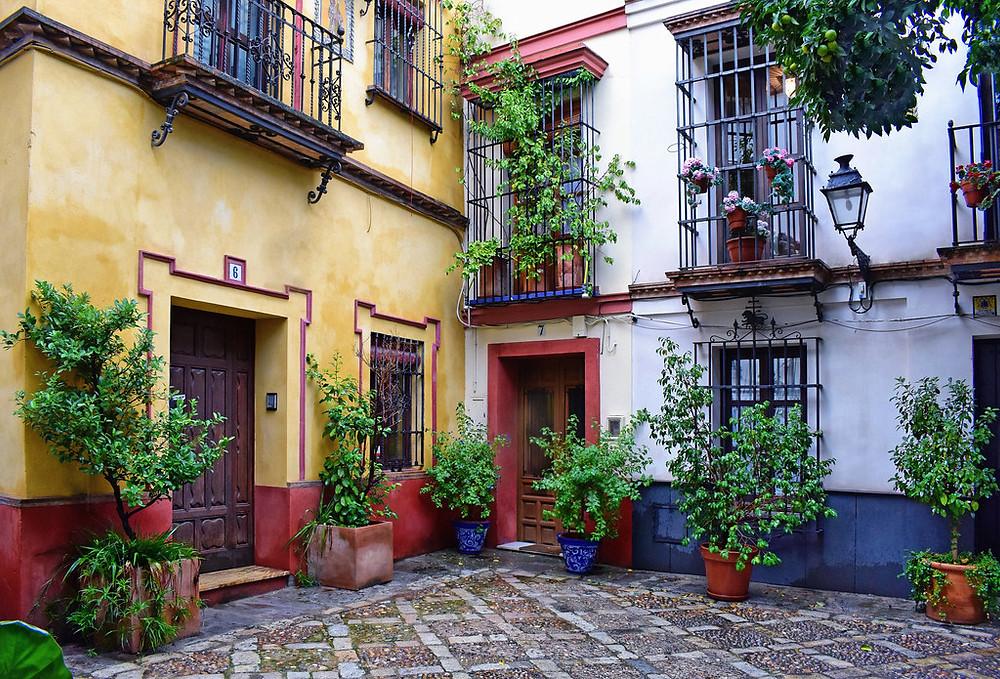 a colorful patio in Barrio Santa Cruz. image source: Jocelyn Erskine-Kellie Flickr