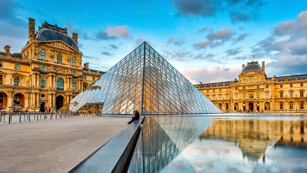 the Louvre Palace and the I.M. Pei Pyramid in Paris France