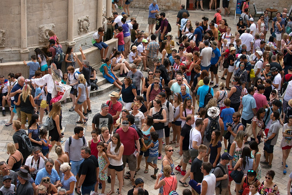 Tourists surround the 15th century Onofrio Fountain in Dubrovnik