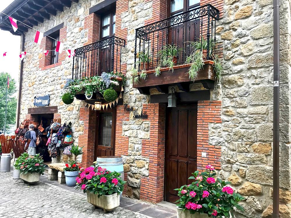 wrought iron balconies and flower pots in medieval Santillana del Mar