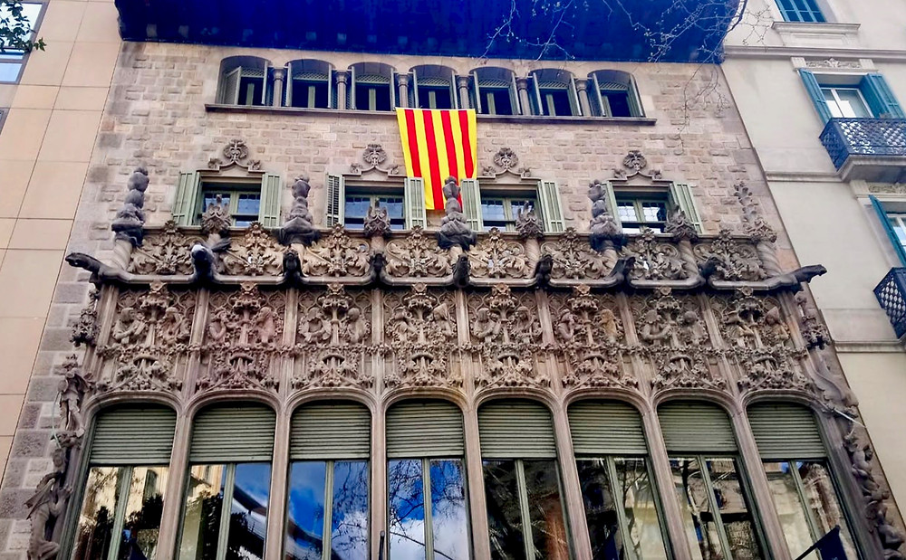 the exuberant Neo-Gothic facade of Palau del Baro de Quadras