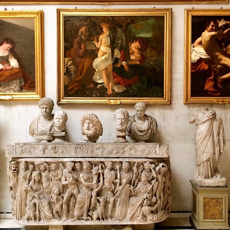 Caravaggio paintings and busts in the Aldobrandini Hall