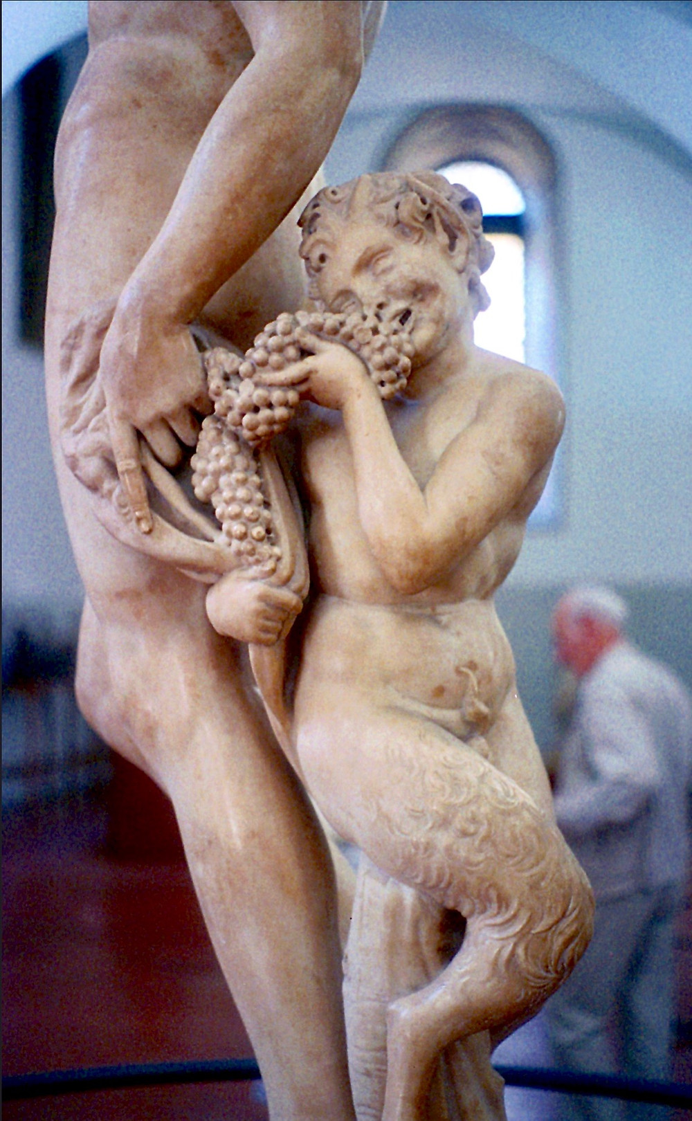 detail of Michelangelo's Bacchus sculpture in Florence's Bargello Museum