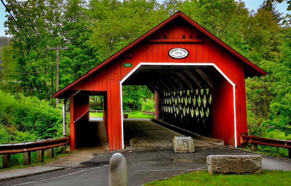 the bright red Creamery Bridge in Brattleboro Vermont