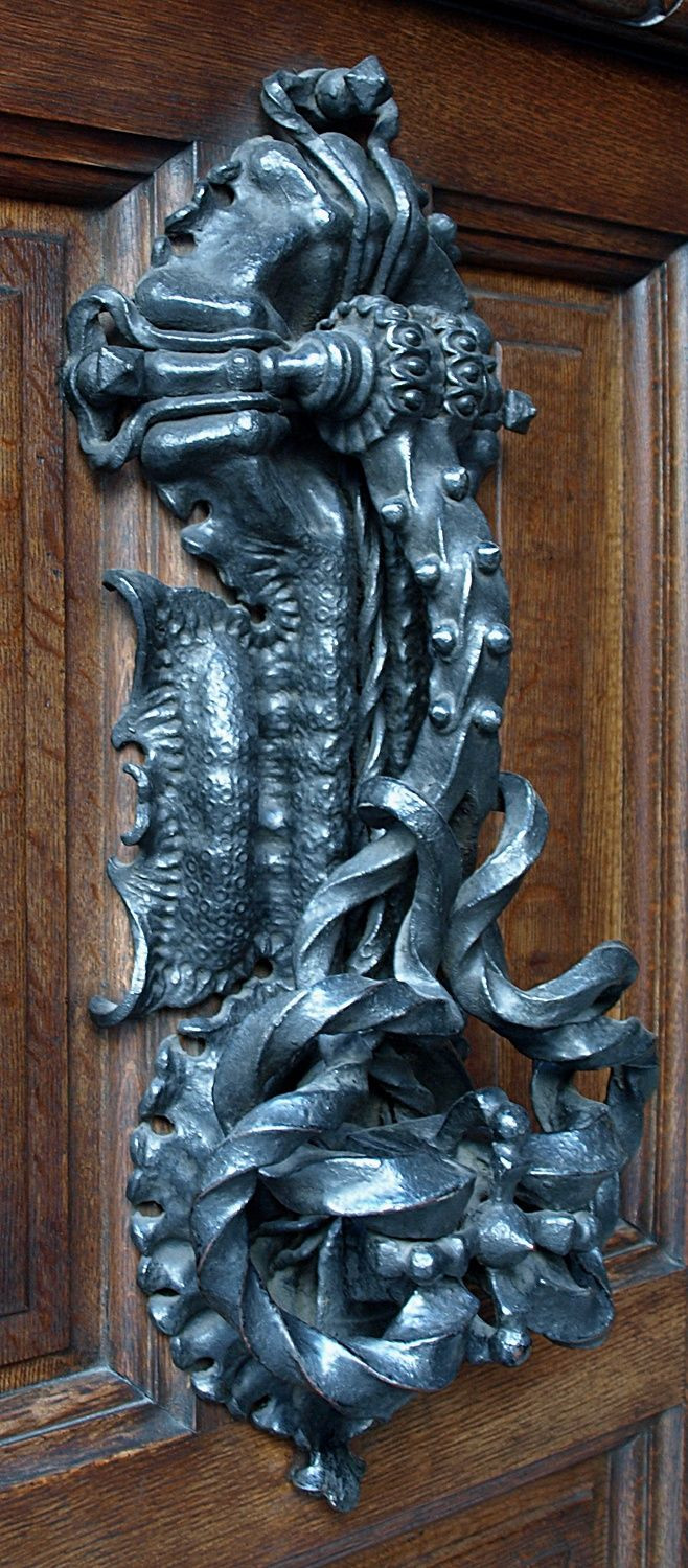 original wrought iron door knocker crushing a bed bug