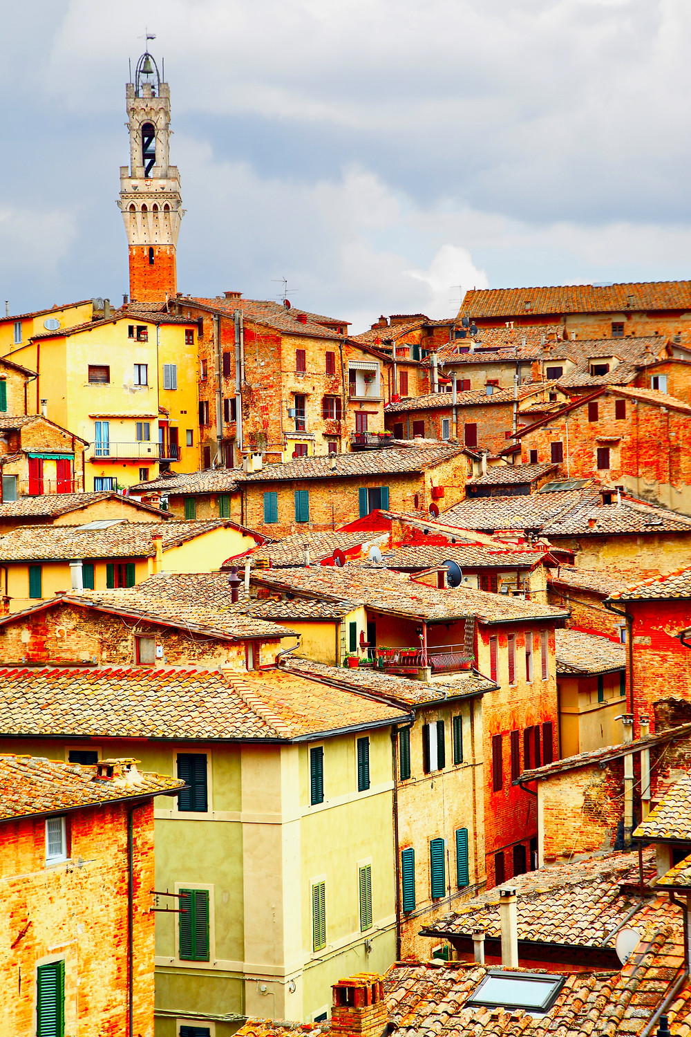 beautiful rustic yellow and orange homes in medieval Siena