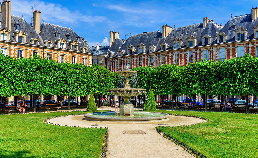 the elegant and classical Place des Vosges in the Marais