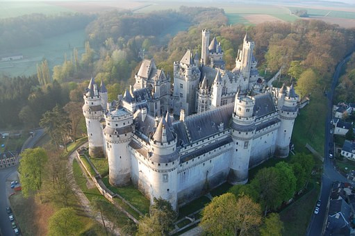 Erected in the late 14th century by Duke Louis of Orléans, the Château de Pierrefonds was taken down in the 17th century and was in ruins when Napoleon III decided to commission architect Eugène Viollet-le-Duc to rebuild it. He applied his architectural designs to create the ideal château, such as would have existed in the Middle Ages.