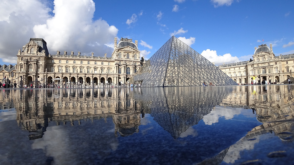 the iconic Louvre Museum, an unmissable site in Paris France