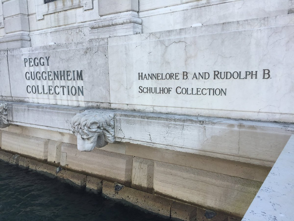 sign giving Peggy Guggenheim and the Schulhofs co-equal billing