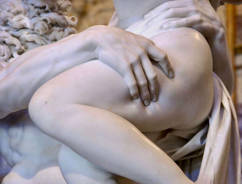 detail where the marble looks so real that indentations appear on Persephone's thigh