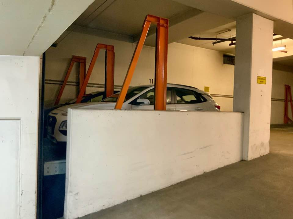 My little white car named Gretel, squeezed in a tight spot on a car elevator at my Air Bnb in Nuremberg