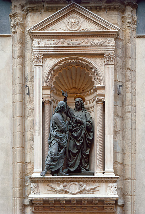copy of Verrochio's Doubting Thomas in a niche on the exterior of Orsanmichele
