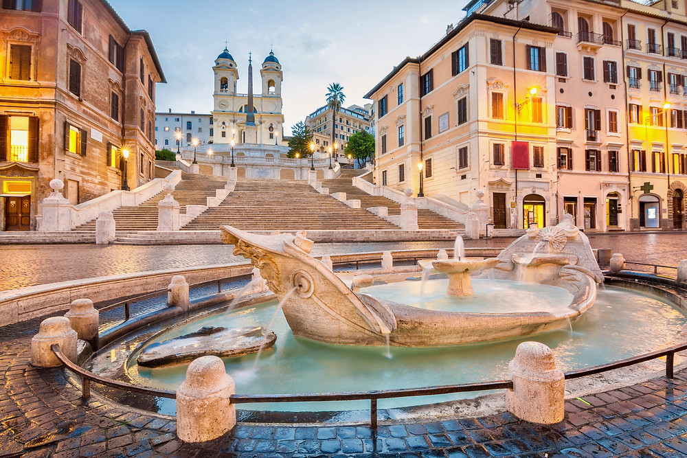 the Sinking Boat Fountain in the Piazza di Spagna in front of the Spanish Steps