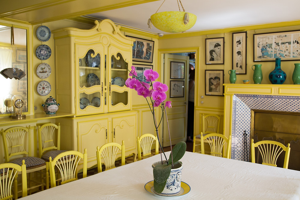 the the bright yellow dining room in Monet's Giverny house