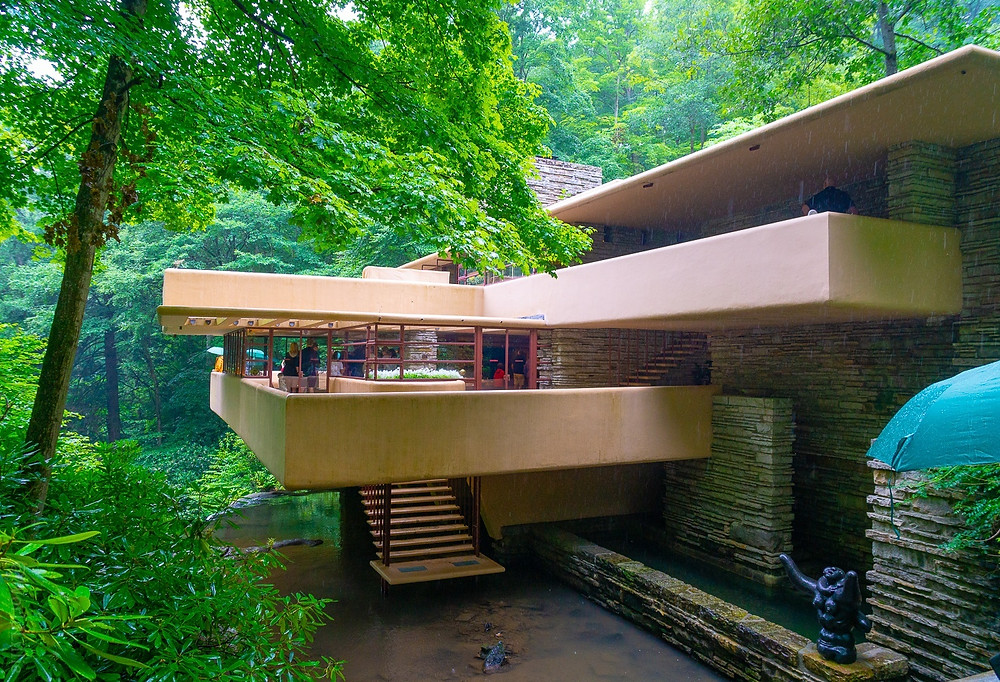 """At the bottom of the photo, you see the """"hatch"""" of Fallingwater's living room, with a stairway leading to the stream below. In the bottom right corner is a sculpture, Mother and Child,  by Joseph Lipschitz."""