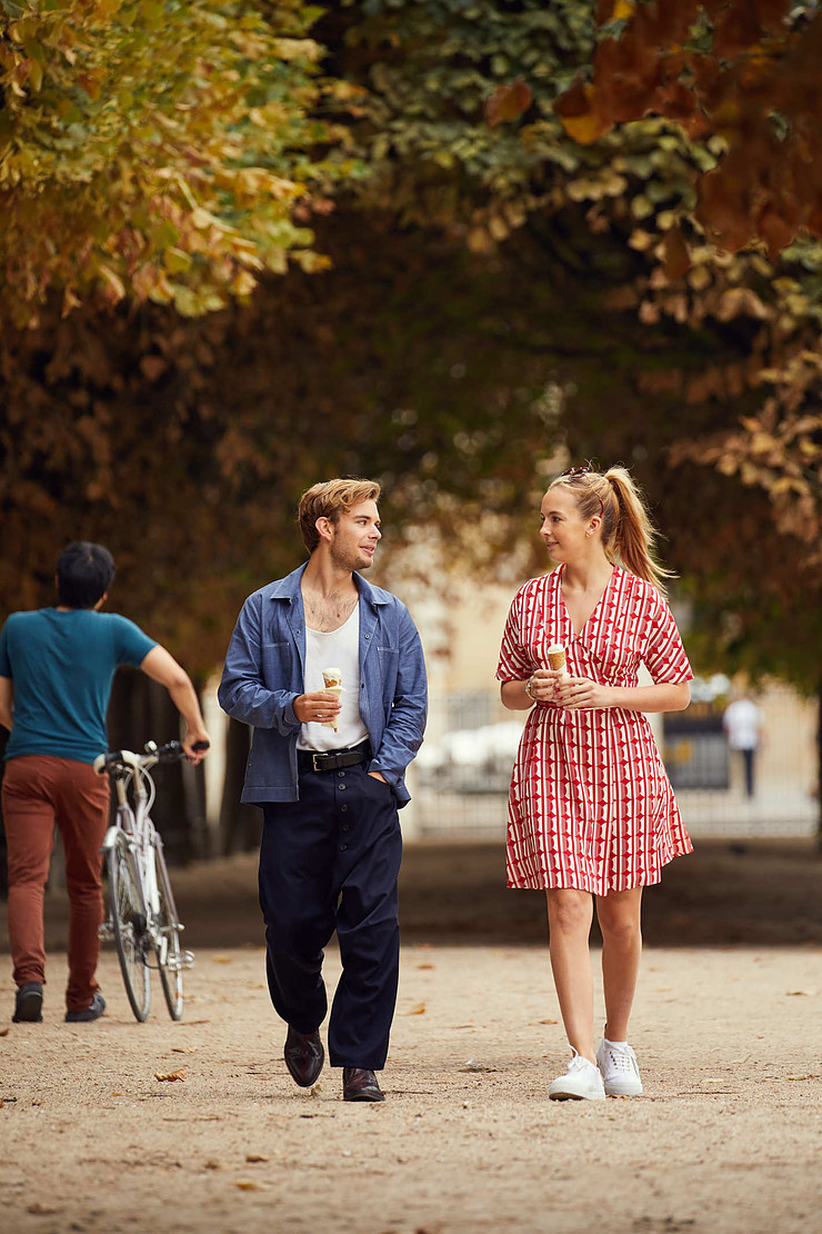 Villanelle and Sebastian walk in the Jardin des Tuileries for which Villanelle dons a playful Mui Mui dress.