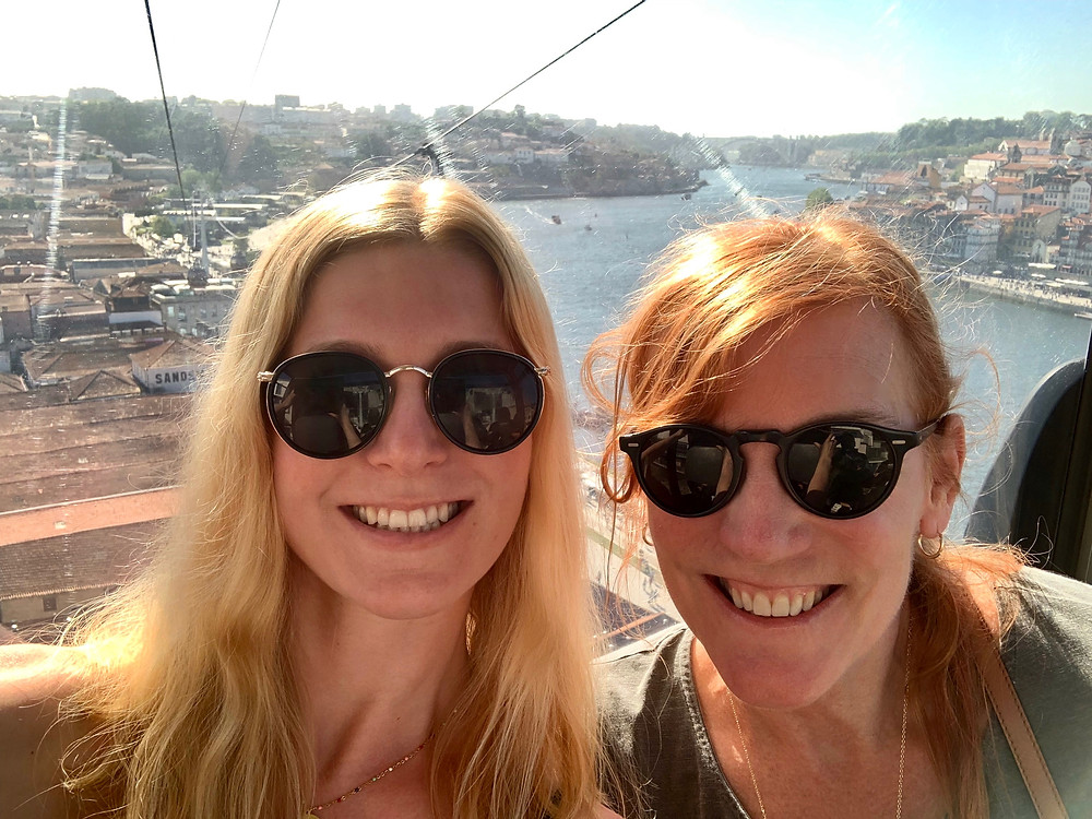Ali and I riding the Teleférico de Gaia cable car