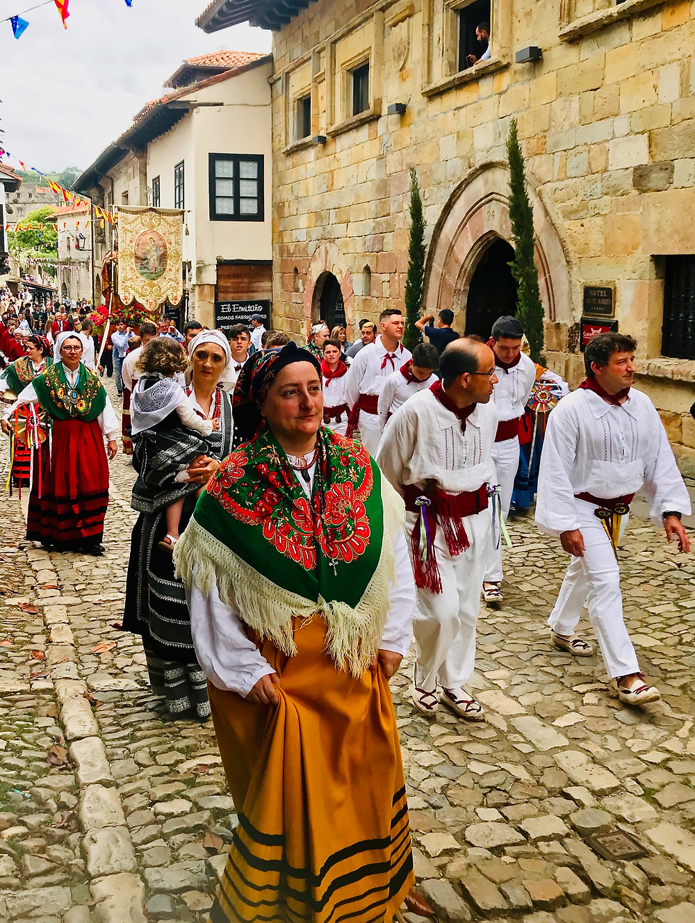 a religious procession to the Colegiata in Santillana del Mar