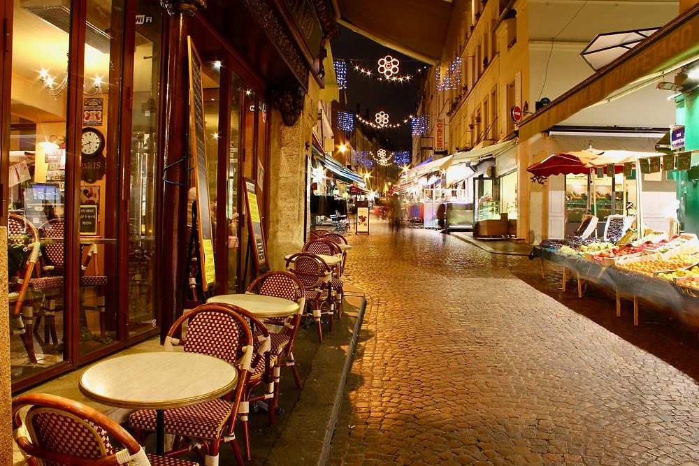 the cobblestones of Rue Mouffetard at night, in Paris' Latin Quarter