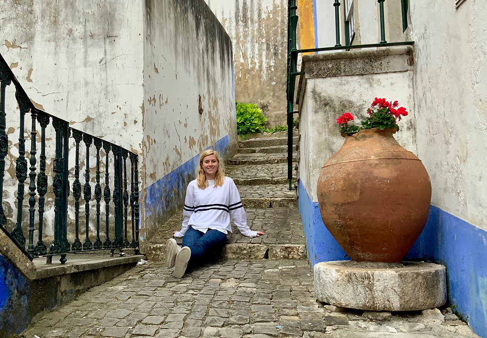 my daughter on a cobbled lane in Óbidos