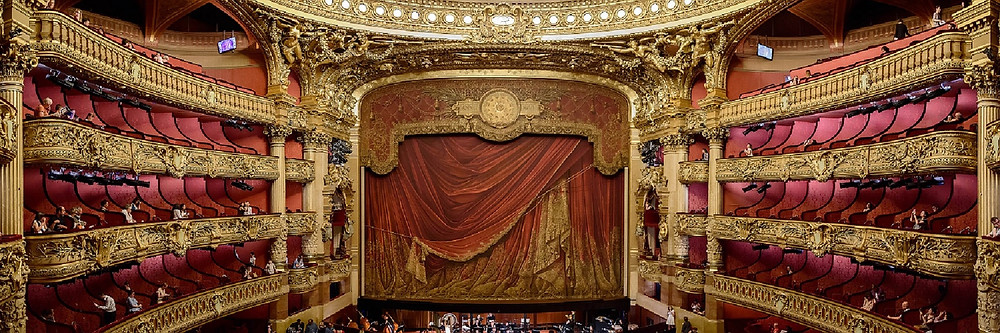 sweeping view of the red velvet and gold in the Opera Garnier in Paris