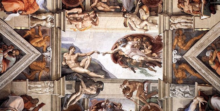 Michelangelo's Creation of Adam in the middle of the Sistine Chapel ceiling