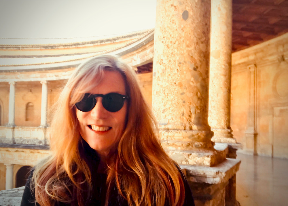 me at the Charles V Palace at the Alhambra with lipstick on my teeth