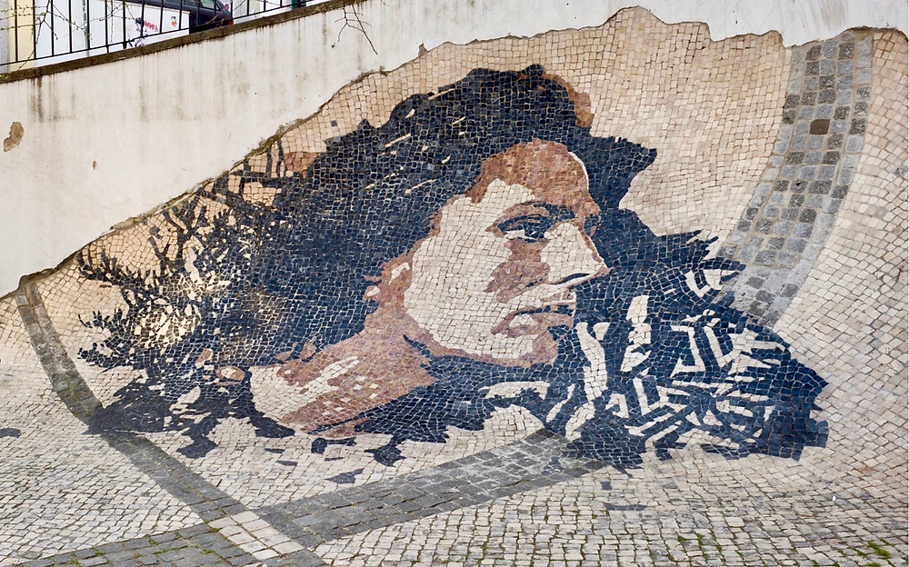 a patterned pavement of Fado singer Amalia Rodrigues in Alfama