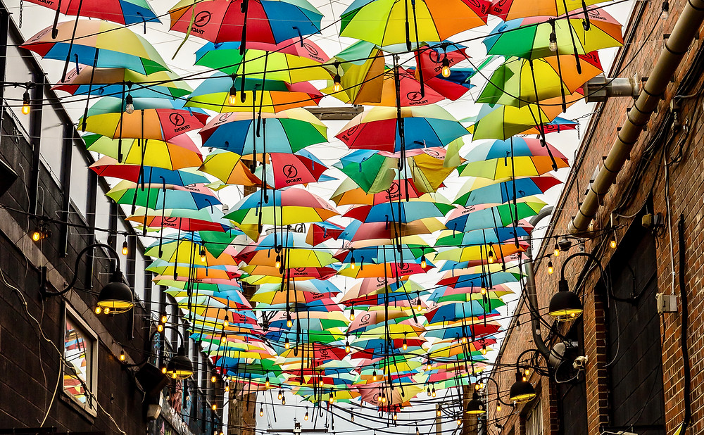 umbrella street decorations in a narrow alley of RiNo