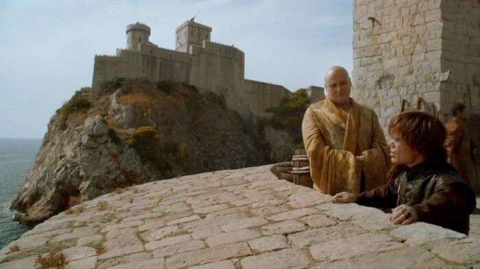 A CGI'd image of Fort Loverijenac in the background, Varys and Tyrion in the foreground at Fort Bokar