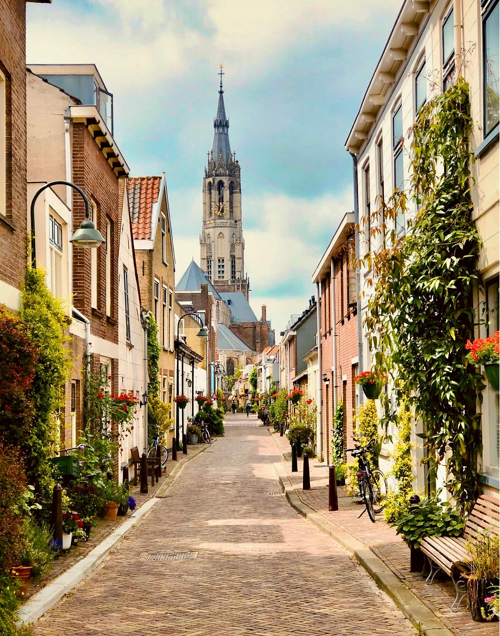 cobbled street in Delft with the New Church in the background
