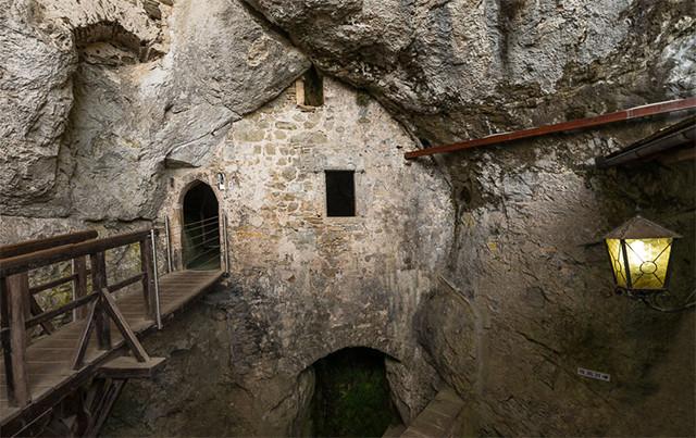 spot where the natural rock meets the castle's facade