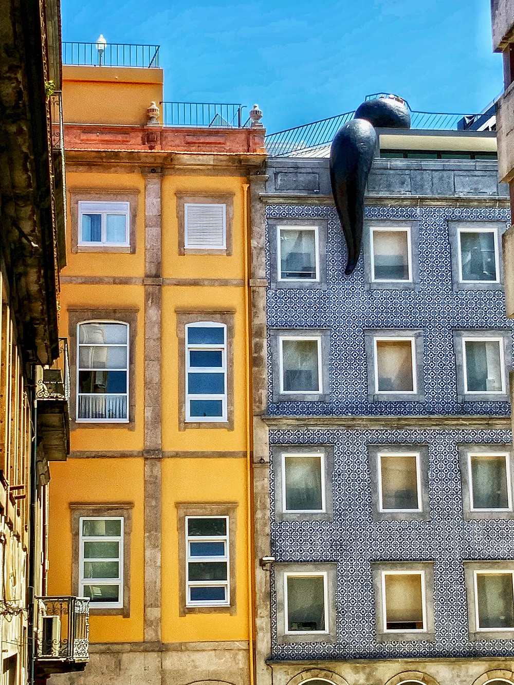 blue and white tiled home in Porto with an art installation slug